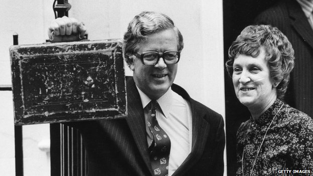 Conservative chancellor of the exchequer Sir Geoffrey Howe holds up the Budget Box on leaving 11 Downing Street with his wife on Budget Day