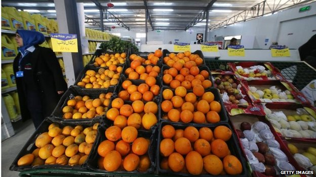 Syrian refugees shop at the first supermarket to open in Zaatari camp, on 6 February
