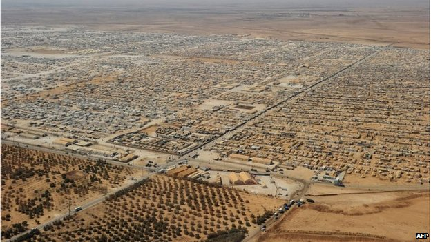 An aerial view taken in July 2013 shows the Zaatari refugee camp, home to some 130,000 Syrians, near the Jordanian city of Mafraq