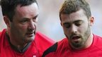 Leigh Halfpenny is helped off after injuring his shoulder against England