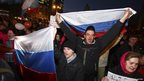 Pro-Russian demonstrators take part in a rally in Donetsk