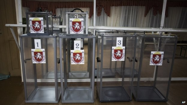 Ballot boxes with the coat of arms of Crimea are seen in a polling station in the municipality of Dobroe, near Simferopol in Crimea