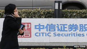 Woman in front of Citic sign