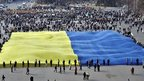 Protestors in Ukraine with the country's flag