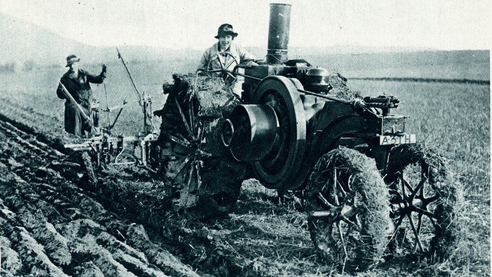 Woman ploughing a paraffin 16 h.p tractor, specially-built for war time agriculture, capability of ploughing five archers a day.