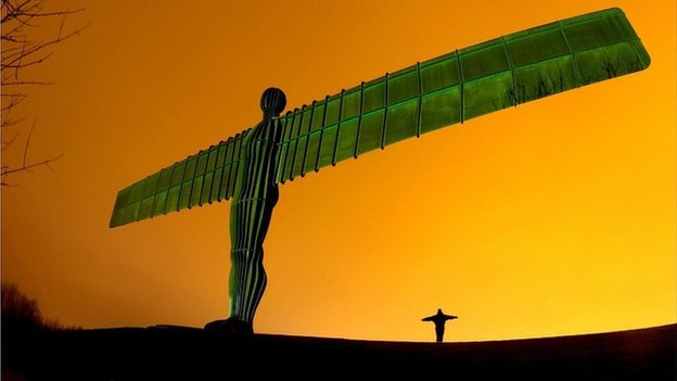 The Angel of the North lit green