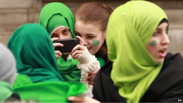 Girls in green hijabs in Trafalgar Square in London