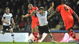 Chris Martin tumbles over after a challenge in Derby's game against Bolton