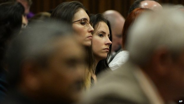 Sister of Oscar Pistorius, Aimee Pistorius, right, sits in court on the tenth day of proceedings in Pretoria, South Africa, Friday March 14, 2014.