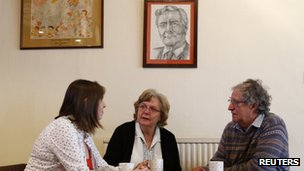 Members of the Labour Club in Chesterfield drink tea under a portrait of Tony Benn.