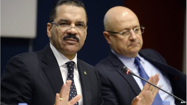 Interpol Secretary General Ronald Kenneth Noble (L) speaks next to Executive Director of Police Services Jean-Michel Louboutin in Lyon, France (11 March 2014)