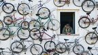 House decorated with old bicycles