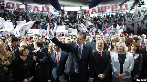 Serbian Deputy Prime Minister and the leader of Serbian Progressive Party (SNS) Aleksandar Vucic (C) waves to his supporters during a rally in Belgrade on 11 March 2014.
