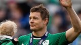 Brian O'Driscoll waves to the Dublin crowd with daughter Sadie in his arms