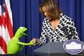 US First Lady Michelle Obama greets Kermit the Frog