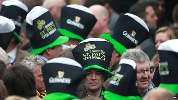 Racegoers at Cheltenham in their Guinness hats