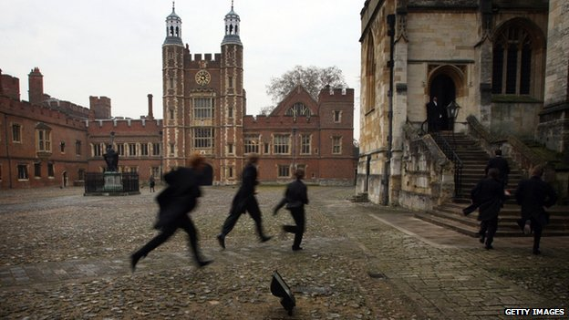 Boys race their way to chapel across the historic cobbled School Yard of Eton College on 17 November 2007
