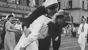 US Navy sailor Glenn Edward McDuffie (L) kisses a nurse in Times Square in an impromptu moment at the close of World War Two, after the surrender of Japan was announced in New York 14 August 1945