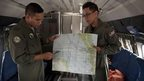 Malaysian Air Force officials show locations on a map during their search. Photo: 14 March 2014