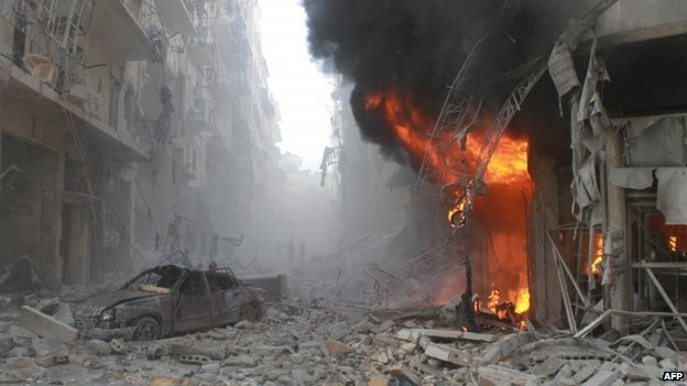 Aftermath of a government air strike in Sukkari district of Aleppo (7 March 2014)