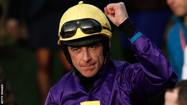 Jockey Davy Russell riding Lord Windermere celebrates after winning the Cheltenham Gold Cup Steeple Chase race on the final day of the Cheltenham Festival horse racing meeting at Cheltenham Racecourse.