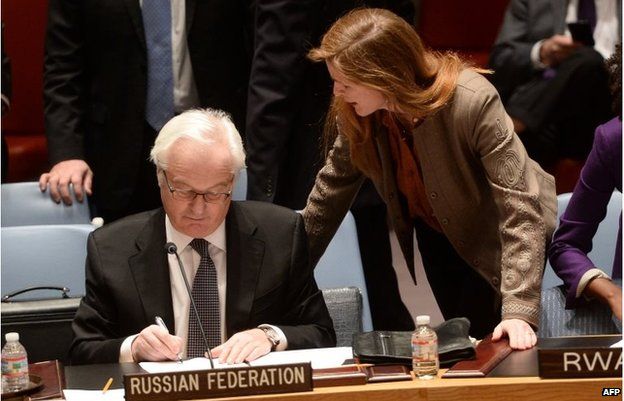 Samantha Power talks with her Russian counterpart Vitaly Churkin at United Nations headquarters in New York on March 15