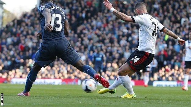 Fulham's Ashkan Dejagah (right) scores the winner against Newcastle