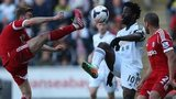 West Brom's James Morrison challenges Swansea's Wilfried Bony for the ball