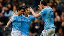 Edin Dzeko celebrates with his Man City team-mates