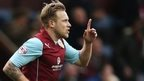 Scott Arfield celebrates after scoring Burnley's winner