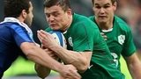 Brian O'Driscoll tries to make headway through the French midfield