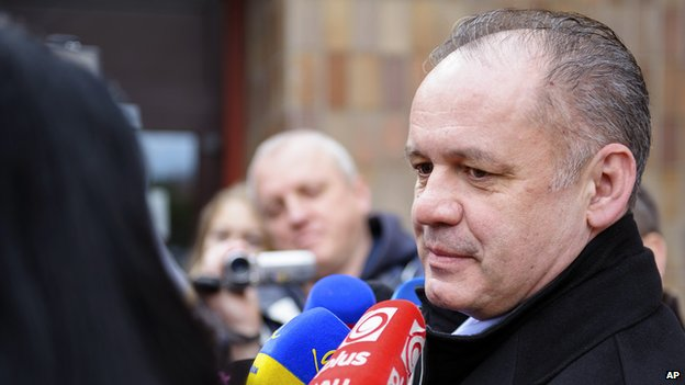 Candidate Andrej Kiska speaks to journalists after casting his ballot for the Slovak presidential election in Poprad, 300 kilometres (186 miles) northeast of Bratislava, Saturday, March 15, 2014.