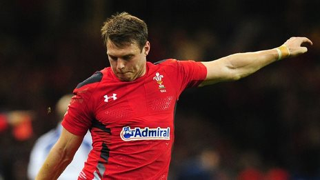Dan Biggar kicks at goal for Wales