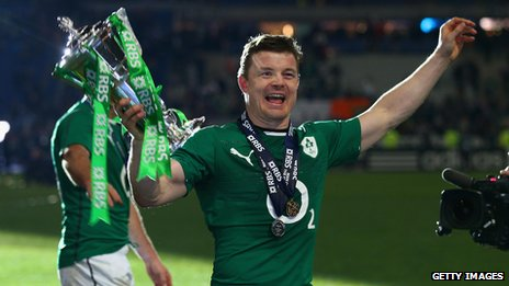 Ireland's Brian O'Driscoll celebrates with the Six Nations trophy