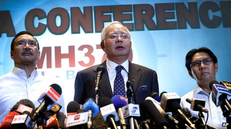 "Malaysian Prime Minister Najib Razak, centre, Malaysia""s Minister for Transport Hishamuddin Hussein, left, and director general of the Malaysian Department of Civil Aviation, Azharuddin Abdul Rahman, delivers a statement to the media on the missing Malaysia Airlines jetliner MH370"