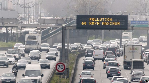 Road sign on Peripherique ring road in Paris, 15 March 2014