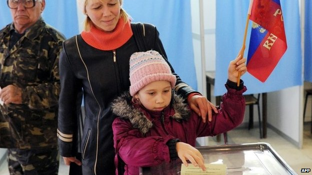 A child votes for her mother Voters in Crimean referendum, 16 March 2014