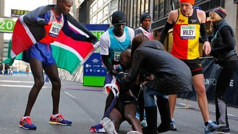 Mo Farah collapses after crossing finish line