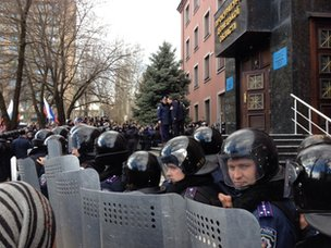 Police and pro-Russian supporters in a stand off in Donetsk on 16 March
