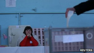 An election official watches voting in a referendum at a polling station in Simferopol on 16 March 2014.