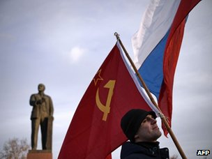 A Crimean man holds a Soviet Union flag in Simferopol's Lenin Square on 16 March 2014.