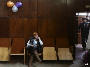 A woman sits at a polling station as people arrive to cast their ballots in Bakhchisaraj, Ukraine, on 16 March 2014.