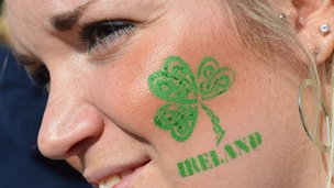 Woman with Shamrock painted on her face