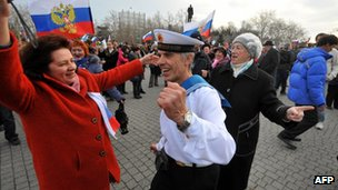 Pro-Russian supporters dance as they celebrate in Sevastopol on 16 March 2014.