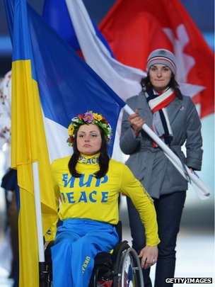 Ukraine's Flagbearer and Cross Country skier Lyudmyla Pavlenko (front) enters the stadium during the Sochi 2014 Paralympic Winter Games Closing Ceremony on 16 March 2014
