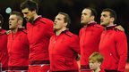 Gethin Jenkins, winning a record breaking 105th cap for Wales, lines up with his team-mates ahead of the final Six Nations match of the season against Scotland in Cardiff.