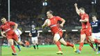 After George North adds a second try, Jamie Roberts runs in to score before half-time to extend Wales' lead over 14-man Scotland.