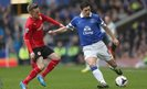 Cardiff City's Craig Noone challenges Everton midfielder Gareth Barry during the Premier League game at Goodison Park.