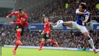 Cardiff City midfielder Gary Medel has a shot blocked by Everton left back Leighton Baines.