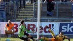 Newport County defender Harry Worley scores an own goal to give Exeter City the lead in the League Two clash at Rodney Parade